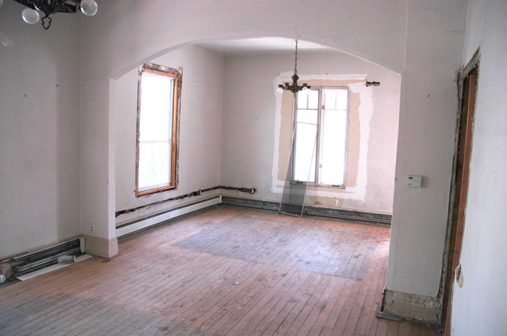 Bright but run-down living room before renovation.
