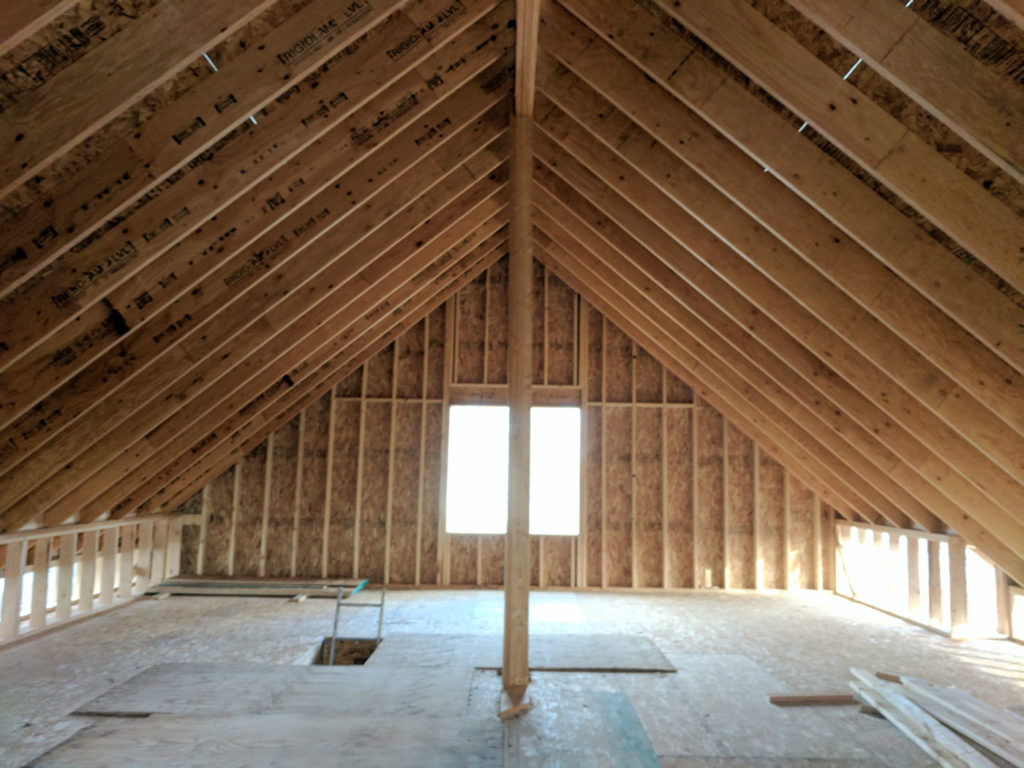 Inside the newly framed second floor, showing LVL roof rafters.
