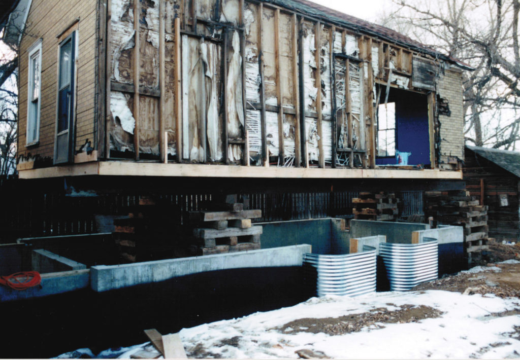 The dilapidated Simpson mine scale house after it was moved to the back of the Lewis farm house, about 1998.