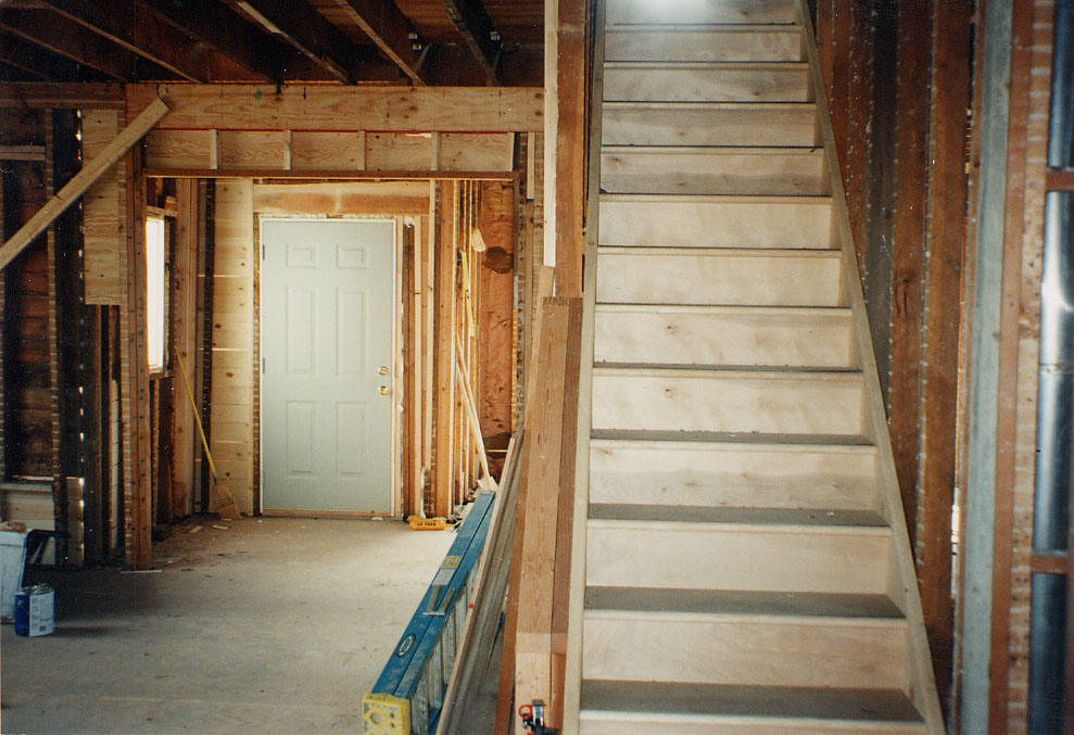 Renovation in progress about 1995, showing the front entry and the main stairs