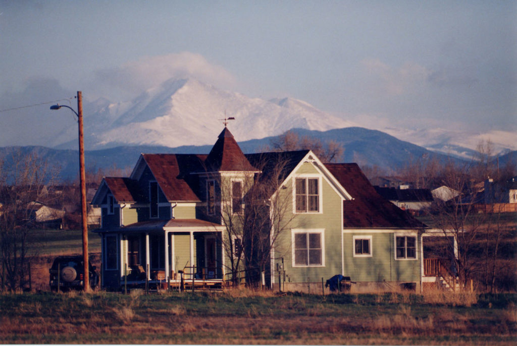 The Thomas House isolated against Longs Peak using a very long lens. Photo by longtime friend Ed Kosmicki.