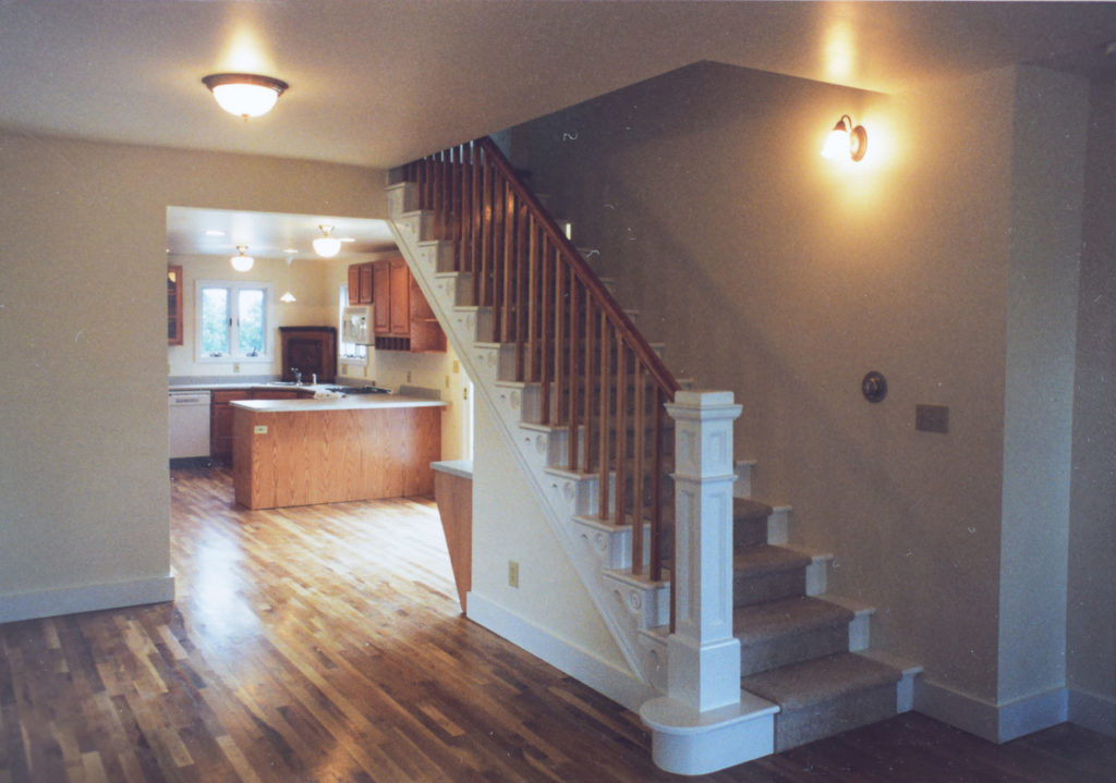 The remodeled interior staircase leading to the new addition at 700 Dounce Street in Lafayette.