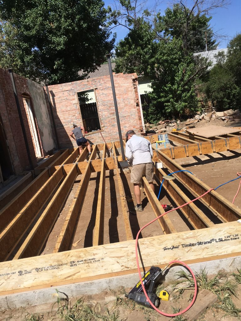 Floor joists are suspended off of a complex steel frame superstructure.