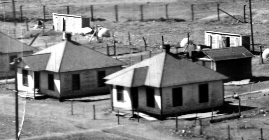 Several Type H houses at the Simpson Mine circa 1920. The homes were built in 1910 in response to increasing labor tensions between union miners and absentee mine owners.