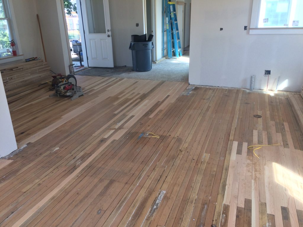 Patching the original old growth, end grain fir flooring.